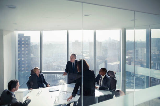 Business colleagues talking in meeting room stock photo