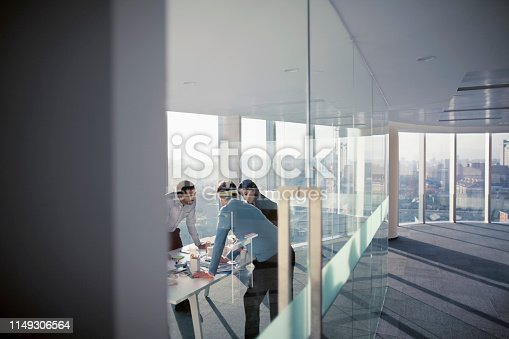 istock Business colleagues talking in planning meeting 1149306564