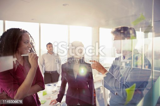 istock Business colleagues talking in planning meeting 1149306676
