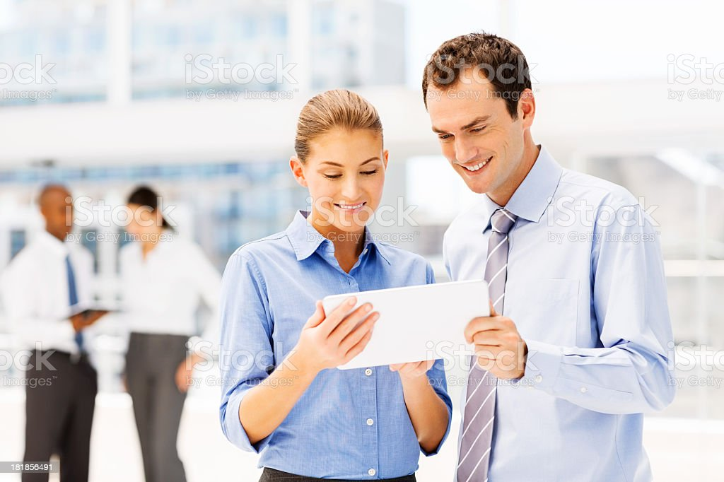 Business Colleagues Using Digital Tablet royalty-free stock photo