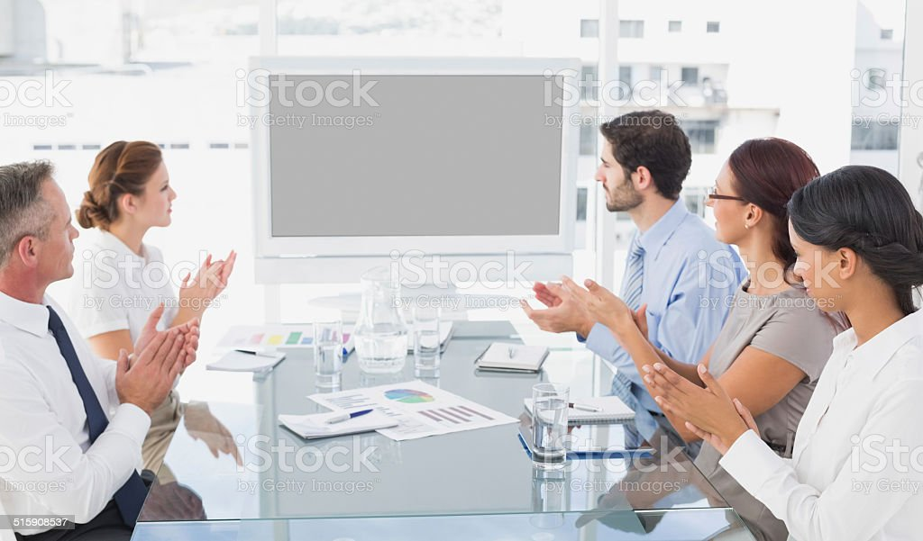 Business colleagues watching video presentation stock photo