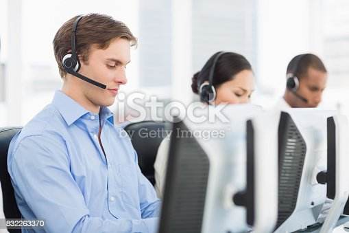 istock Business colleagues with headsets using computers in office 832263370