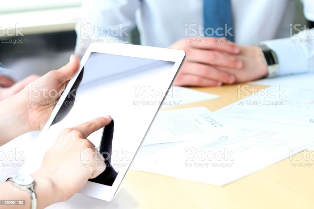 Business colleagues working and analyzing financial figures on a digital tablet royalty-free stock photo