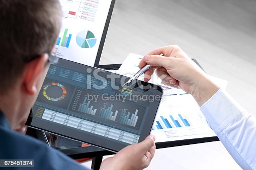 istock Business colleagues working and analyzing financial figures on a graphs 675451374