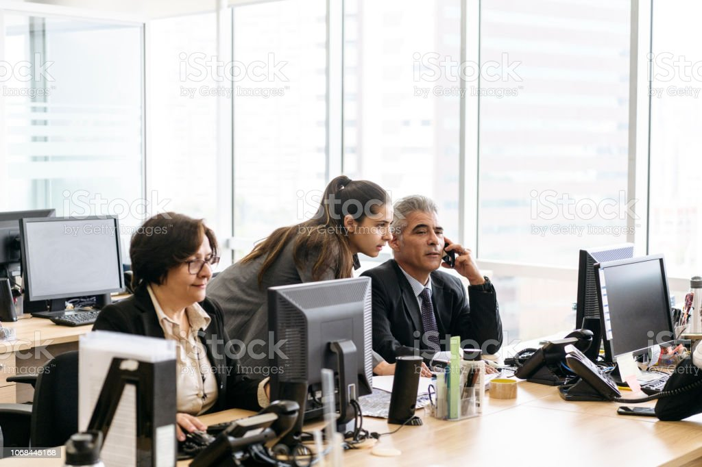 Business colleagues working in busy modern office stock photo