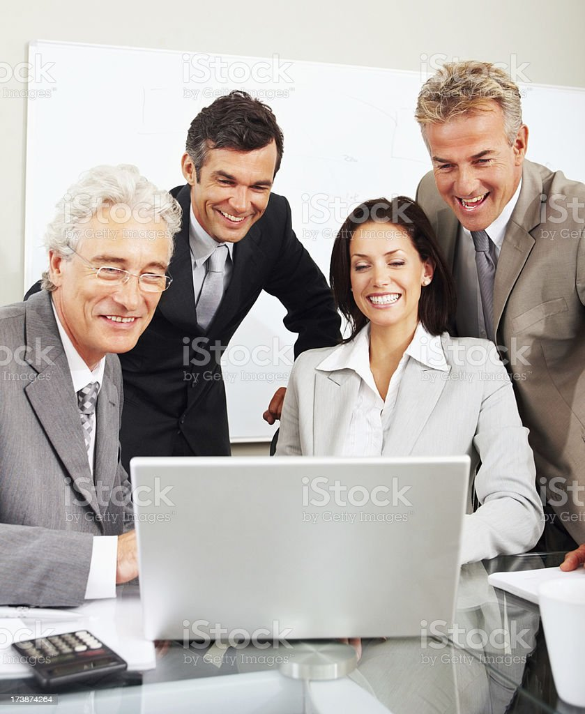 Business colleagues working on laptop royalty-free stock photo
