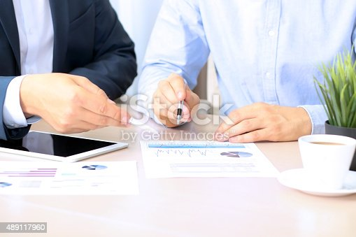 672116416istockphoto Business colleagues working together and analyzing financial figures 489117960