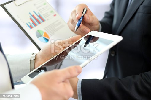 672116416istockphoto Business colleagues working together and analyzing financial figures 496232456