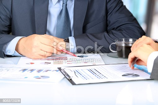 672116416istockphoto Business colleagues working together and analyzing financial figures 505372028