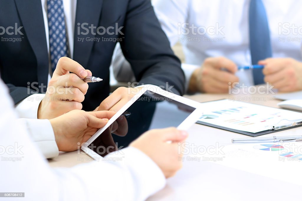 Business colleagues working together and analyzing financial figures stock photo