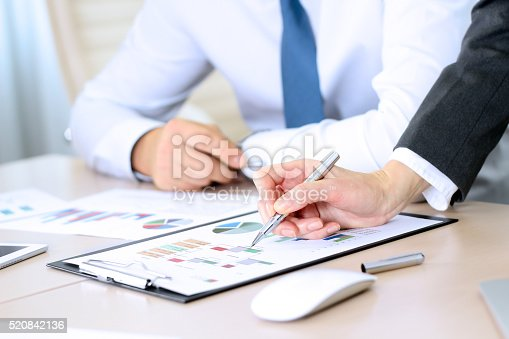 672116416istockphoto Business colleagues working together and analyzing financial figures 520842136