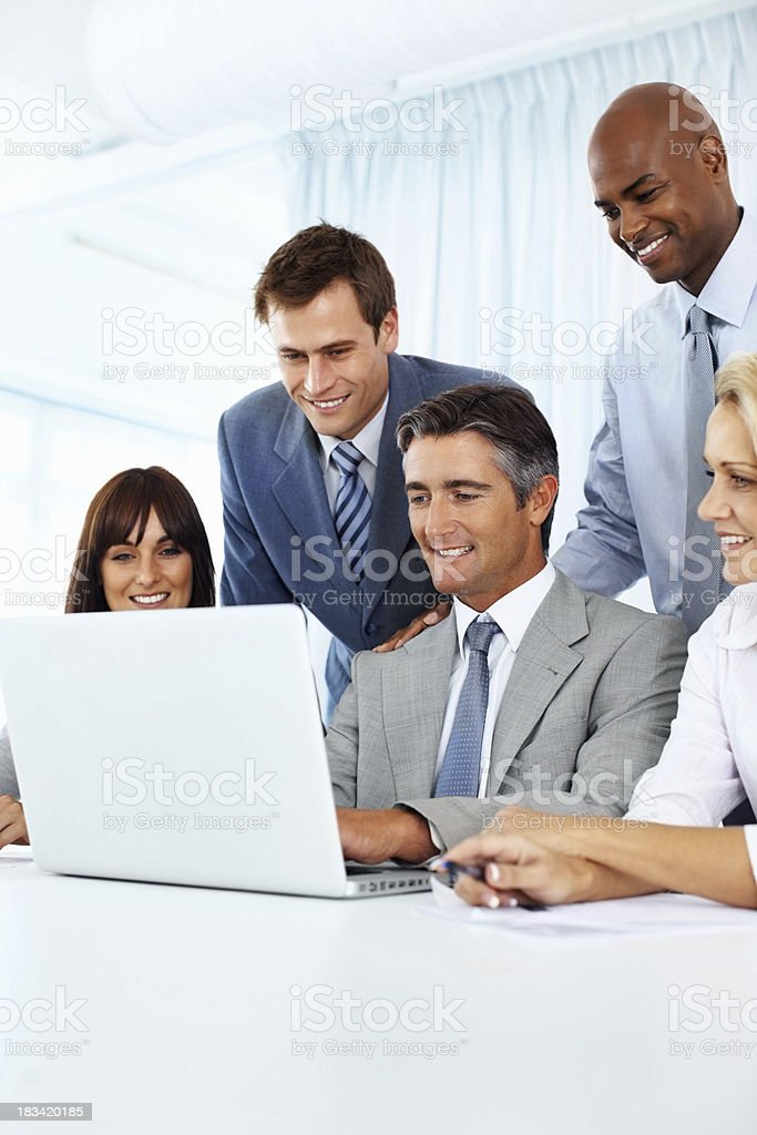 Business colleagues working together on laptop royalty-free stock photo