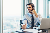 Businessman working and talking on the phone in the office