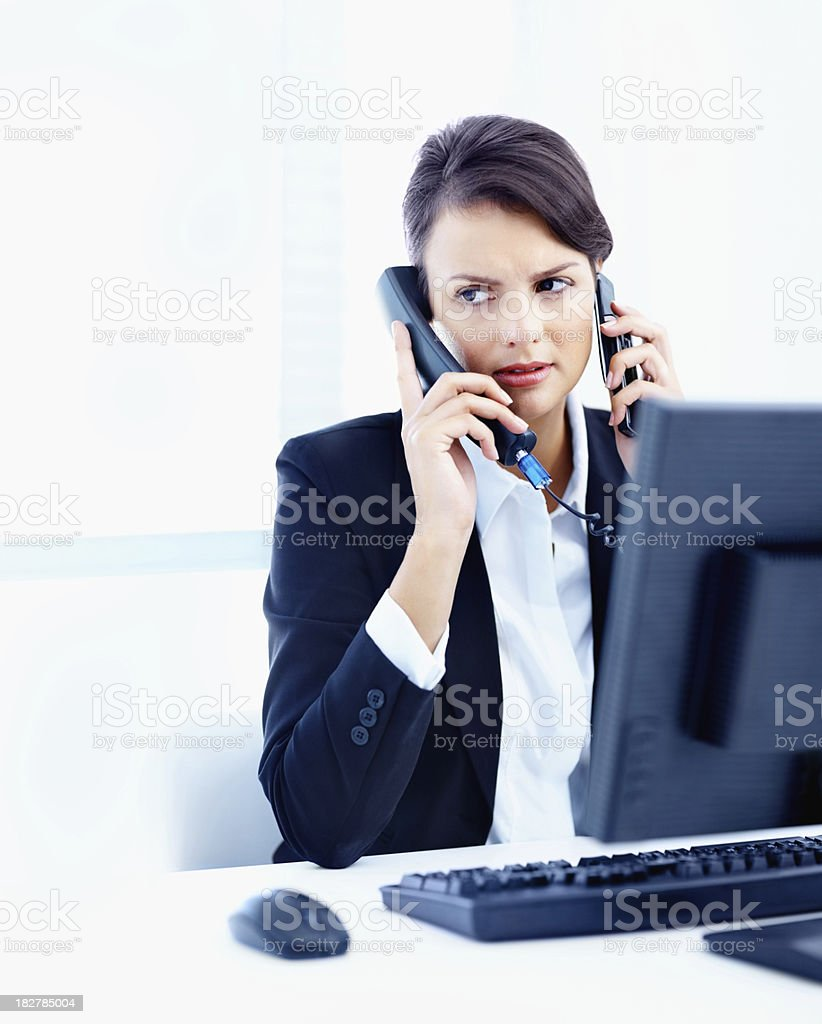 Business communication - Woman at her desk doing multiple tasks royalty-free stock photo