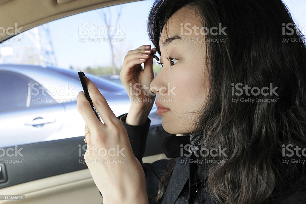 Business Commuter Make-up On Car - XLarge royalty-free stock photo