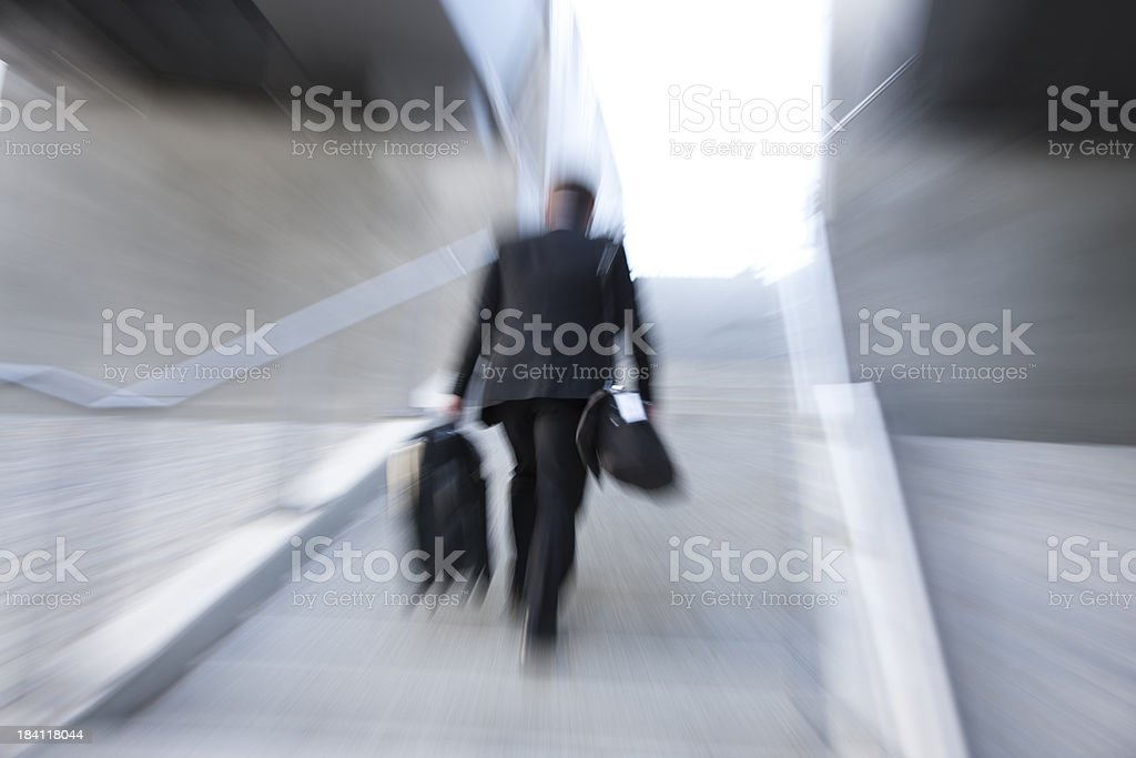 Business Commuter Rushing Upstairs, Carrying Suitcase royalty-free stock photo