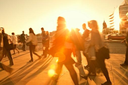 Business Commuters Walking Home After Work, Sunset Backlit, Blurred Motion