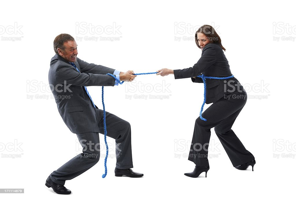 Business competition - Businessman and businesswoman playing tug of war stock photo