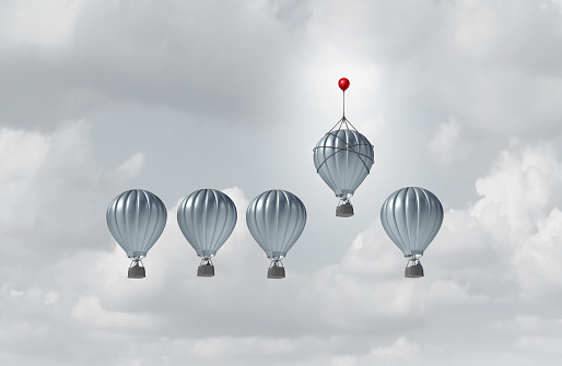 Business competitive advantage success and corporate edge concept as a group of hot air balloons racing to the top but an individual leader with a small balloon winning the competition as a 3D illustration.