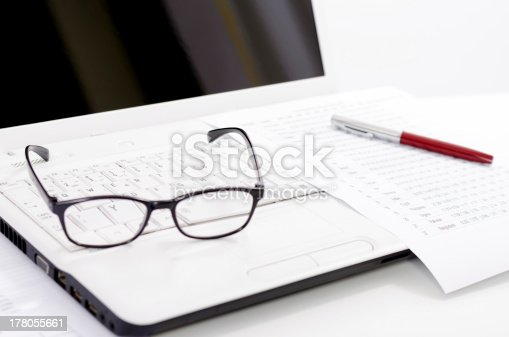 1217929357 istock photo Business composition with laptop glasses pen and statistics sheets 178055661