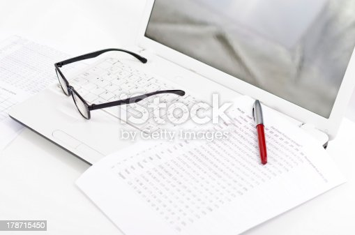 1217929357 istock photo Business composition with laptop glasses pen and statistics sheets 178715450
