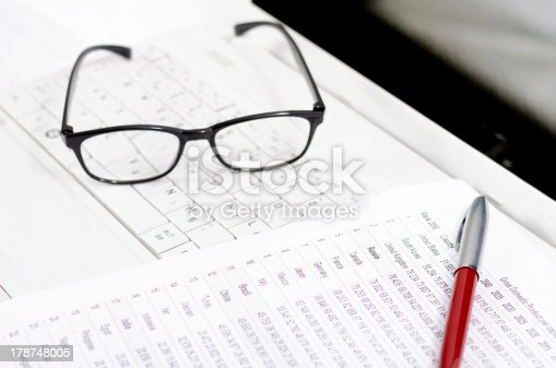 1217929357 istock photo Business composition with laptop glasses pen and statistics sheets 178748005