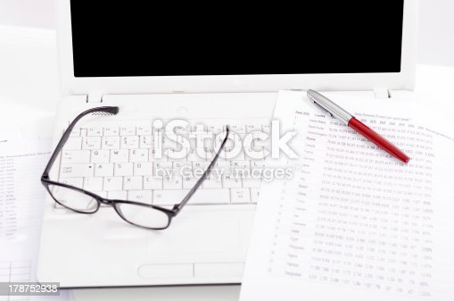 1217929357 istock photo Business composition with laptop glasses pen and statistics sheets 178752938