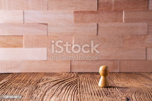 istock Business concept, abstract businessman standing near wall. 1084644614
