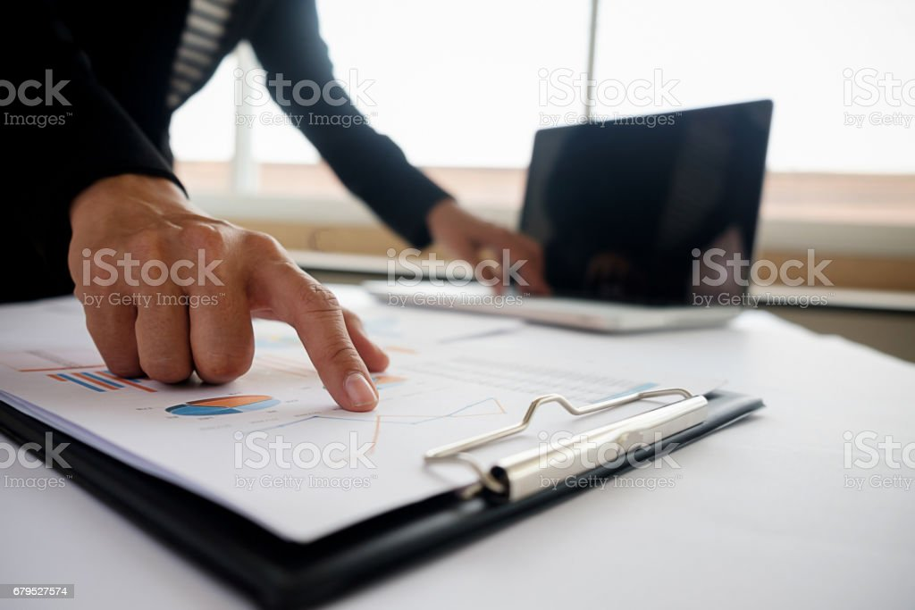 Business concept. Business people discussing the charts and graphs showing the results of their successful teamwork. Selective focus. royalty-free stock photo