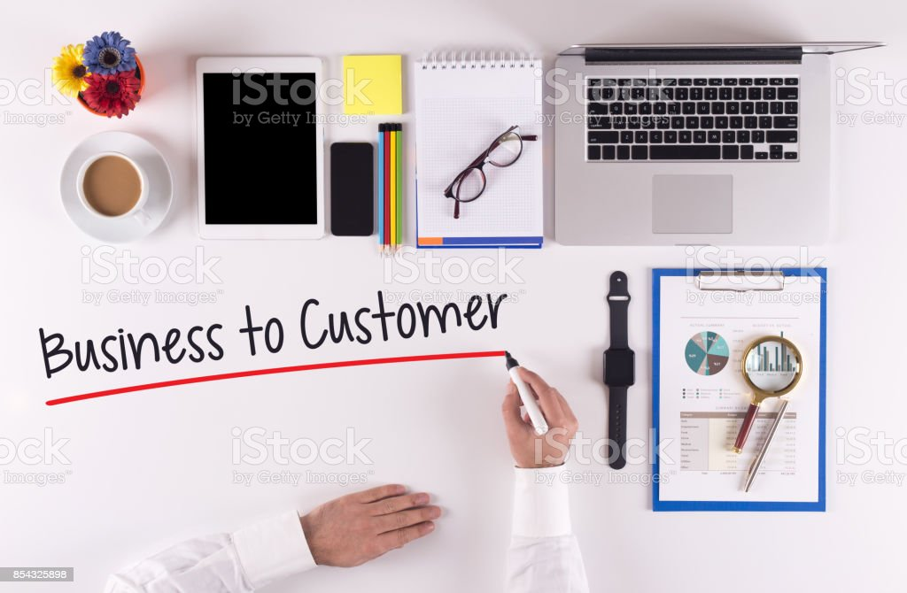 Business Concept: Businessman writing the words B2C stock photo