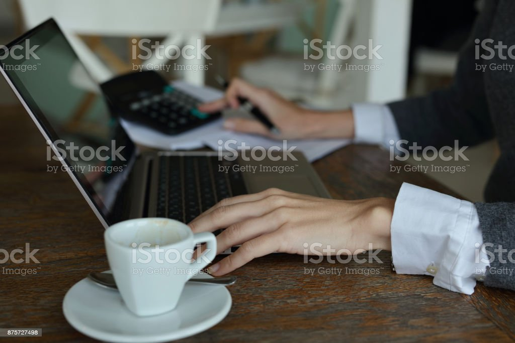 Business concept. Businesswoman using laptop computer in cafe close up stock photo