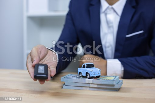 936987338 istock photo Business concept, car insurance, sell and buy car, car financing, car key for Vehicle Sales Agreement. 1154080441
