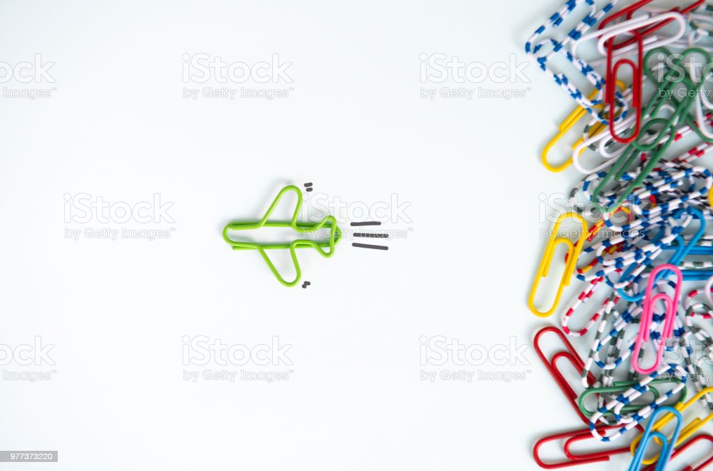 Business concept for group of stacked paperclip with another one green plane paperclip is point to another direction as a team leadership stock photo