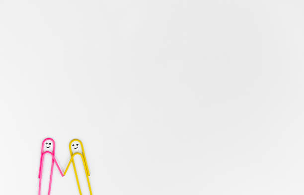 business concept for paper clip as the human shake hand on the white background stock photo