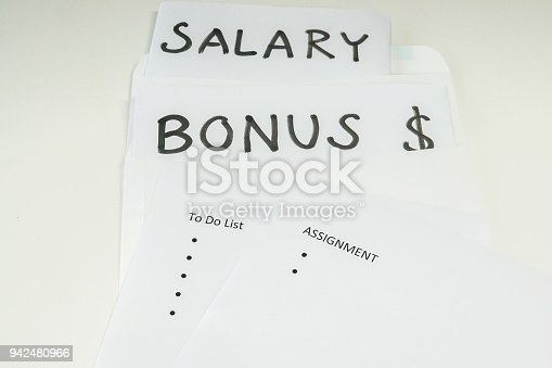 business concept - isolated bonus and salary evaluation based on assignment and goal for employee performance review