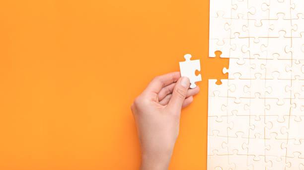 geschäftskonzept des weißen puzzles. - scyther5 stock-fotos und bilder