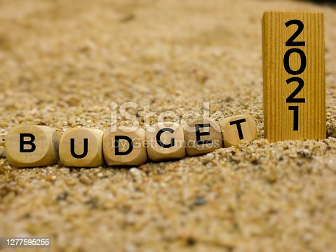 BUDGET 2021 on wooden blocks concept background. Stock photo.