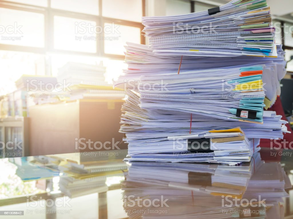 Business Concept, Pile of unfinished business documents on office desk stock photo
