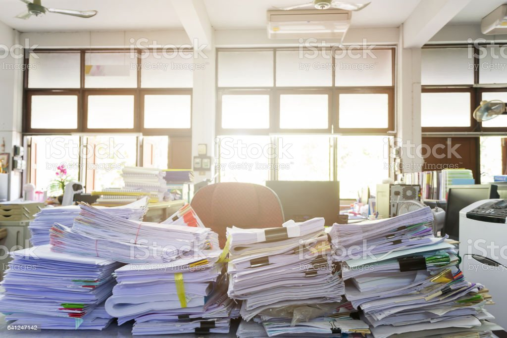 Business Concept, Pile of unfinished documents on office desk stock photo