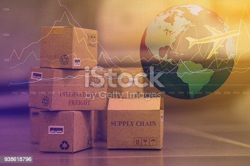 istock business concept: Small cardboard boxes with a plane flies above world map. Concept of  transportation, international freight, global shipping, goods or services remotely.  overseas trade, regional 938618796