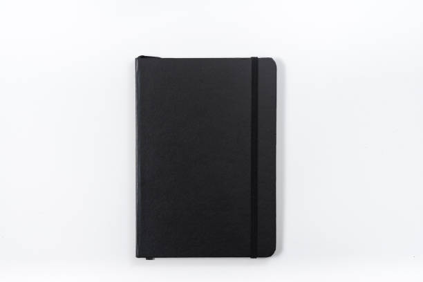 Business concept - Top view collection of black notebook on white background desk for mockup Business concept - Top view collection of black notebook on white background desk for mockup covering stock pictures, royalty-free photos & images