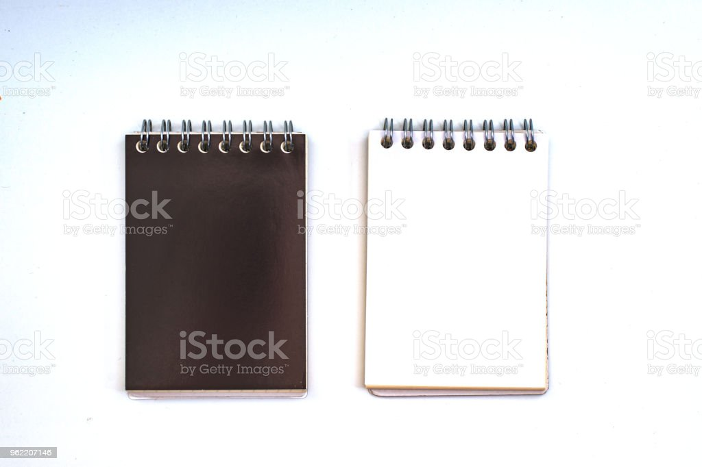 'Business concept - Top view collection of black spiral notebook on white  background desk for mockup' stock photo