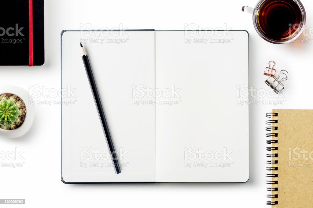 Business concept - Top view of stationery isolated on white desktop background stock photo