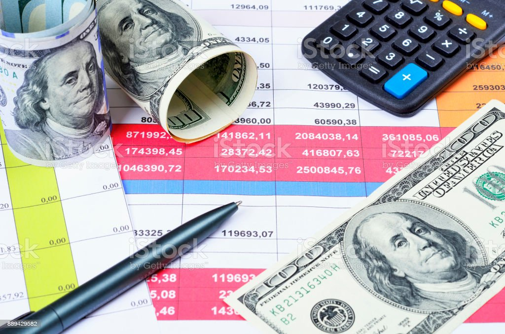 Business concept with calculator,pen,  money and documents stock photo