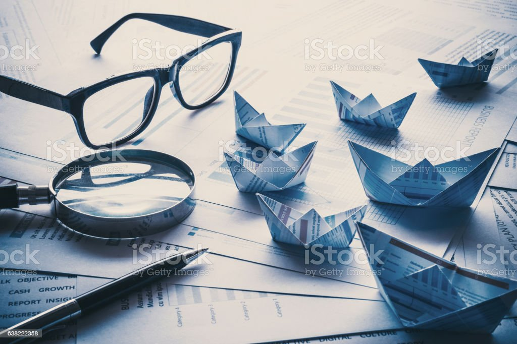 Business concept with group of boats made with document paper. stock photo