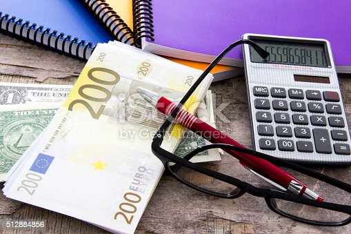 istock Business concept with money Euro and calculator on wooden board 512884856