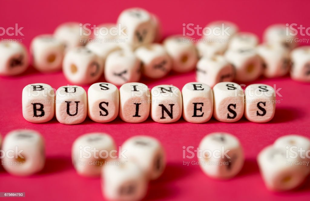 Business concept wood block word on red wallpaper. royalty-free stock photo