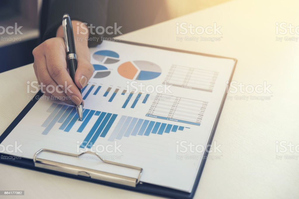 Business concept, Young business woman's hands working with financial graph data and marketing documents report on office table royalty-free stock photo