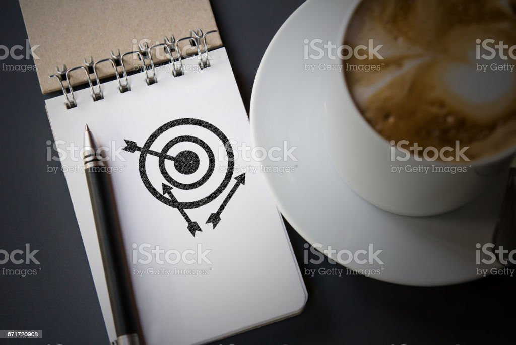 Business concepts of sketch target icon on the notebook stock photo