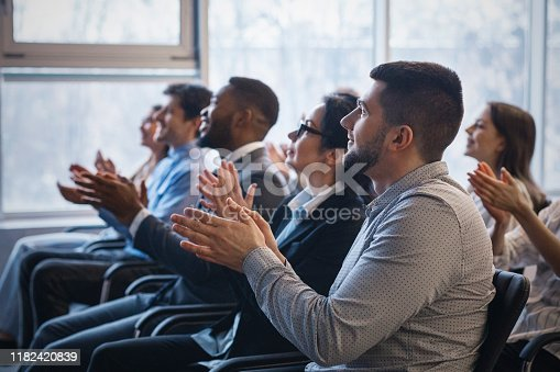 1180918029 istock photo Business conference. Colleagues clapping hands to speaker 1182420839